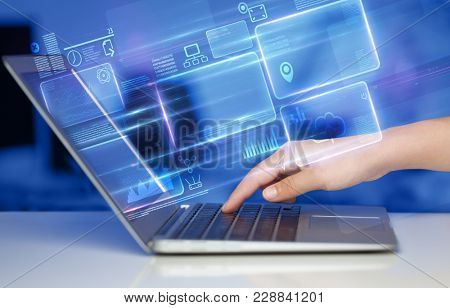 Hand using laptop with database reports and online work concept
