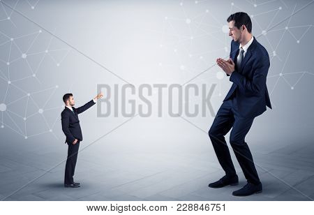 Small businessman aiming at a big businessman with connection and network concept