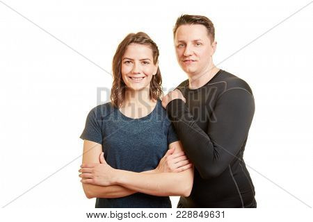 Man and woman young couple as fitness trainers smiling together in teamwork