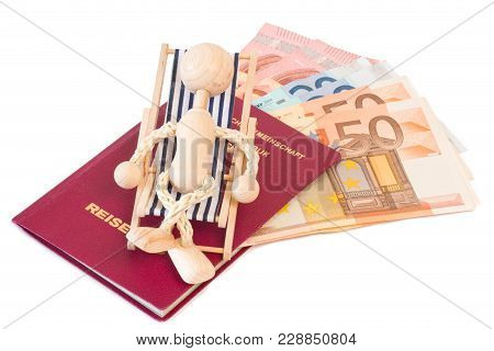 Wooden Puppet On A Mini Deck Chair With Passport And Money