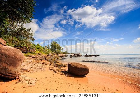 Large Cube Stone By Transparent Sea Under Low Tide