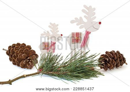 Wooden Reindeer With Pine Branch And Cones On White Background