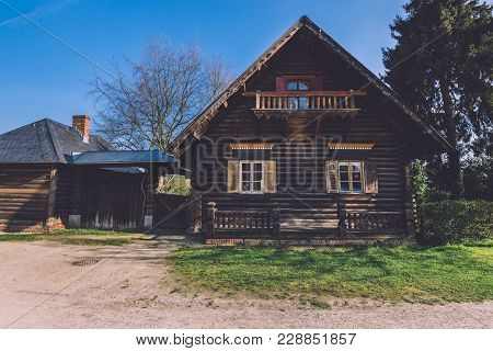 Classic Log House With Shuttered Windows In Russian Colony Village Alexandrowka In Potsdam By Spring