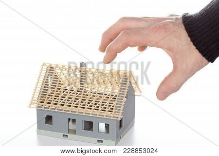 Hand Is Taking A Building Shell, Symbolic Insolvency
