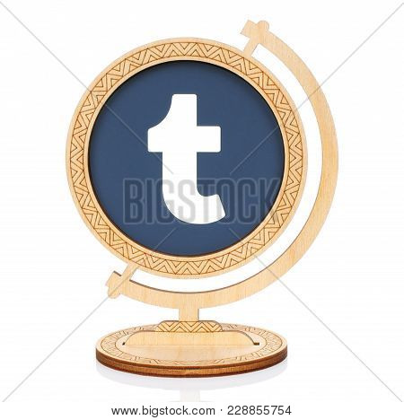 Kiev, Ukraine - November 01, 2017: Tumblr Circle Icon Printed On Paper And Placed Into Wooden Globe