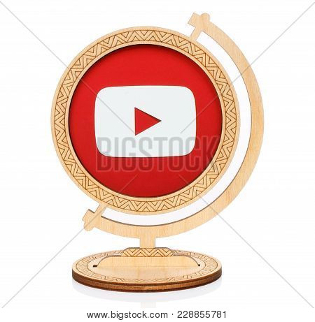 Kiev, Ukraine - November 01, 2017: Youtube Circle Icon Printed On Paper And Placed Into Wooden Globe