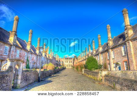 Vicars Close Next To Wells Cathedral Somerset England Uk Historic Row Of Cottages, Houses And Chimne