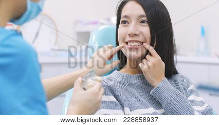 Woman talk to dentist in dental clinic