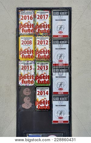 Carcassonne, France - September 5, 2017: Plates Of Recommendation Of Tourist Guide On The Facade Of