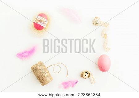 Easter Holiday. Frame Made Of Easter Pink Eggs With Twine, Feathers And Tapes On White Background, T