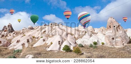 Colorful Hot Air Balloons Flying Over Pigeon Valley In Cappadocia, Anatolia, Turkey