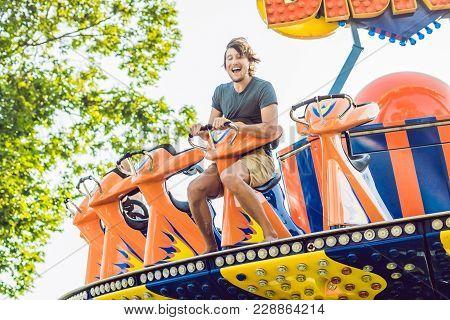 Beautiful, Young Man Having Fun At An Amusement Park.