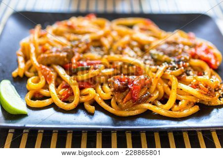 Udon noodles with duck on the plate