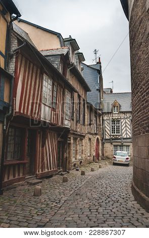 Narrow Cobblestone Alley With Historic Half-timbered Houses In Old City Center Of Rennes, Brittany,
