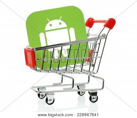 Kiev, Ukraine - November 01, 2017: Android Icon Printed On Paper And Placed Into Shopping Cart. Andr