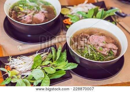 Pho Bo - Vietnamese Fresh Rice Noodle Soup With Beef, Herbs And Chili. Vietnam's National Dish