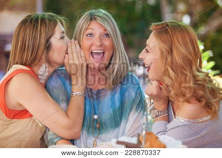 women friends  gossiping scandal