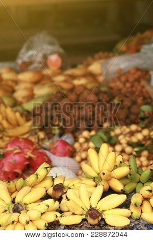 Street Fruit Market. Small Bananas In A Bunch, Dragonfruit, Rambutans, Mangosteen