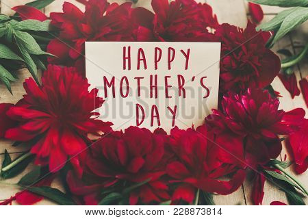 Happy Mother's Day Text Sign On Craft Paper Card Beautiful Red Peonies On Wooden Rustic Background.