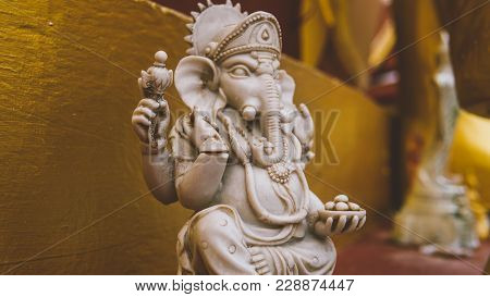 Statue Of Ganesha God Close-up. God Of Wisdom And Prosperity.
