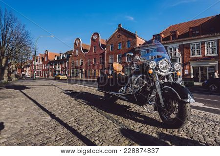 April, 9th, 2017 - Potsdam, Brandenburg, Germany. Classic Motorbike On Dutch District With Holland B