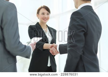 Negotiating business,Image business woman handshake