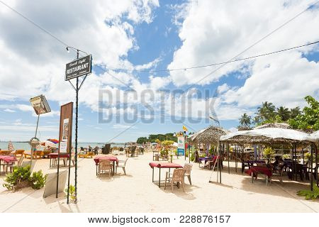 Unawatuna, Sri Lanka, Asia - December 2015 - Some People At A Touristic Restaurant At The Beach Of U