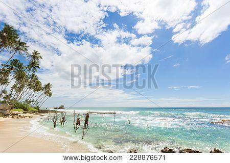 Koggala Beach, Sri Lanka, Asia - December 2015 - Several Native Fishermen At Koggala Beach Practicin