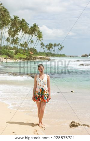 Koggala Beach, Sri Lanka, Asia - A Woman Standing On The Sand At Koggala Beach
