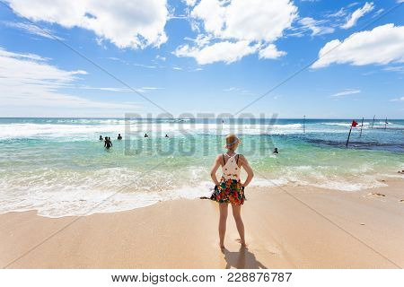 Koggala Beach, Sri Lanka, Asia - A Woman Looking Upon The Indian Ocean At Koggala Beach