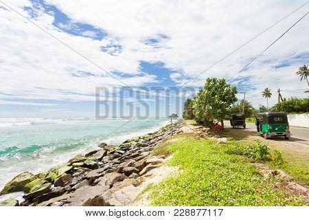Weligama, Sri Lanka, Asia - December 2015 - Tuk Tuk Drivers Having A Rest At The Coastline Of Weliga