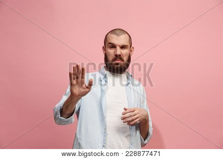 Young Man With Disgusted Expression Repulsing Something, Isolated On The Pink