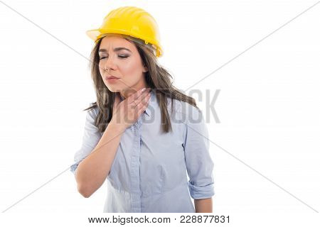 Portrait Of Female Constructor Holding Her Throat Like Hurting.