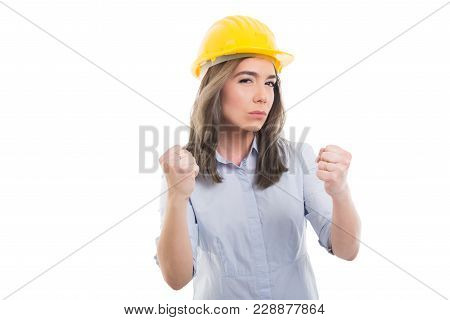 Portrait Of Female Constructor Showing Fists Like Fighting.