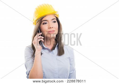 Portrait Of Female Constructor Talking At Telephone.