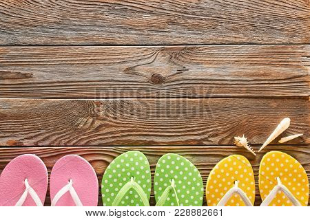 Flip flops over wooden background