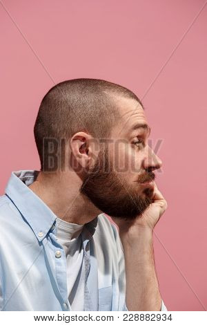 Young Casual Man Is Boring. Emotional Man Is Boring On Pink Studio Background. Male Profile. Human E