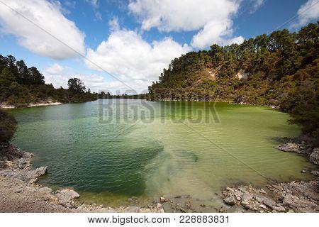 Lake Ngakoro And Waterfall At Wai-o-tapu Geothermal Wonderland Near Rotorua In New Zealand