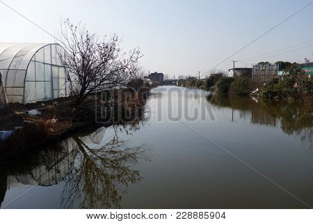 Shanghai, China- Jan 22, 2018: Generic House Of Chinese Rural Village Located Next To The River In S