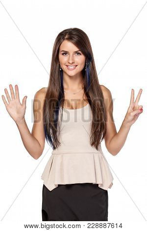 Hand Counting - Seven Fingers. Happy Woman Indicating The Number Seven With Her Fingers