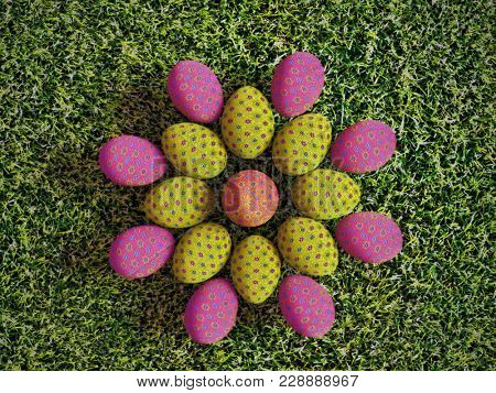 3D render of colorful easter eggs arranged into flower pattern placed on grass shot from above