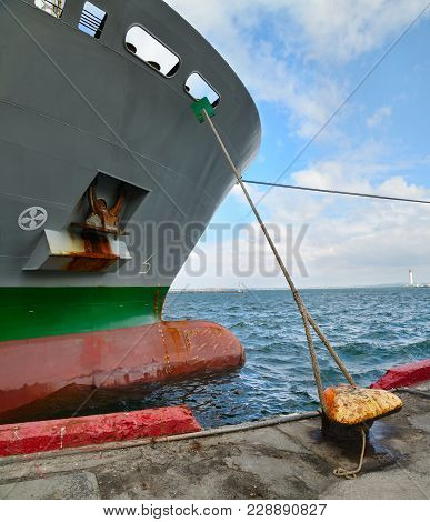 Cargo Ship Docked In Container Terminal In A Sea Port