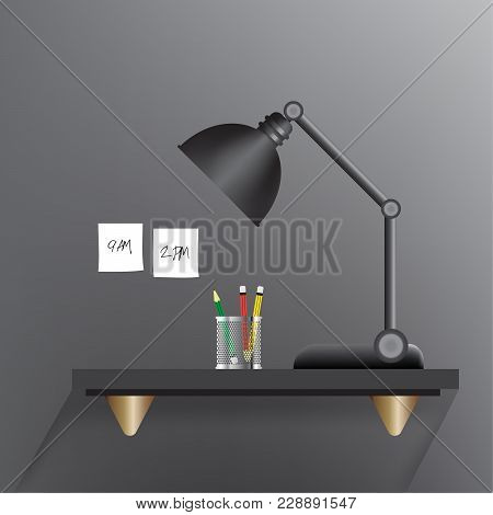 Black Lamp Turn Off On A Black Working Table With A Three Pencils Such As Green,red,yellow In A Mini