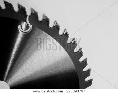 Tool. A Disc Of Metal With Teeth For Sawing Boards. White Isolated Background.