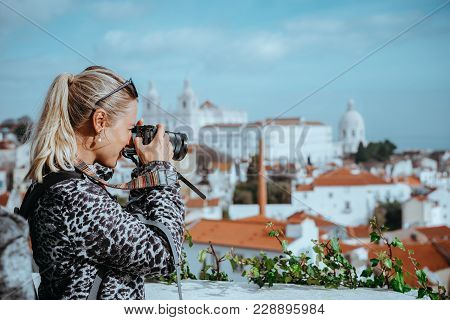 Traveler Woman Make A Picture Of Lisbon Cityscape. The National Pantheon And The Towels Of Vicente D