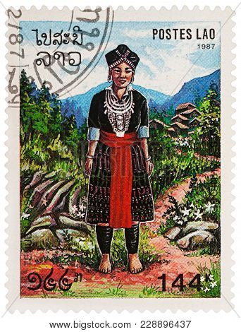 Moscow, Russia - February 28, 2018: A Stamp Printed In Laos, Shows Woman In Traditional Laotian Clot