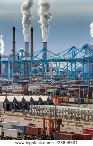 Rotterdam, Netherlands - Sep 8, 2013: Shipping Container Terminal, Cranes And Power Station Emission