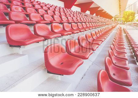 Row Of Red Seat At Public Sport Stadium .