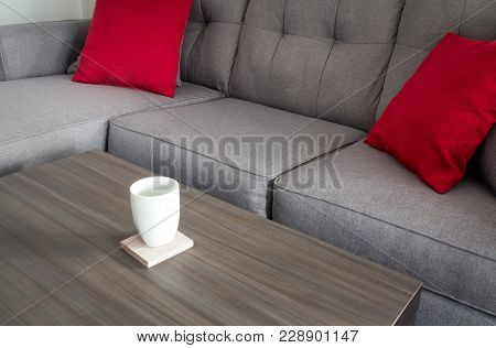 Coffee Mug On Table Living Room With A Couch And Pillow