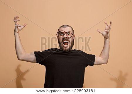 Screaming, Hate, Rage. Crying Emotional Angry Man Screaming On Pastel Studio Background. Emotional,